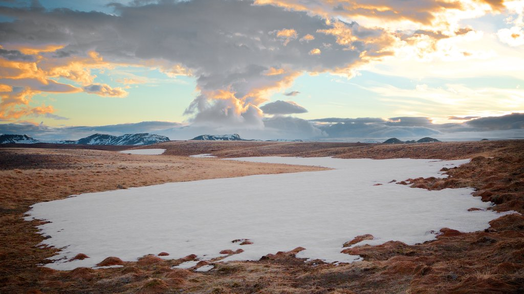 Laugarvatn featuring snow, tranquil scenes and a sunset