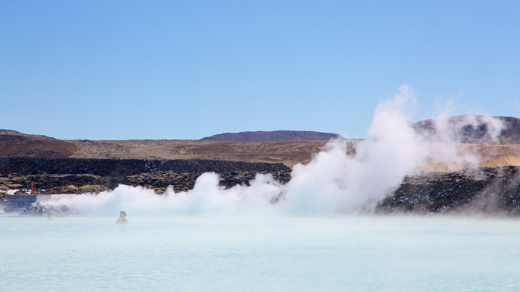 Blue Lagoon showing mist or fog and a hot spring