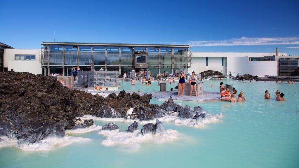 Blue Lagoon featuring a luxury hotel or resort and a hot spring as well as a large group of people
