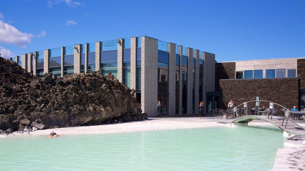 Blue Lagoon which includes modern architecture and a hot spring