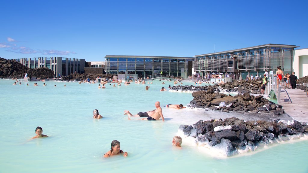 Blue Lagoon showing a hot spring, a luxury hotel or resort and swimming