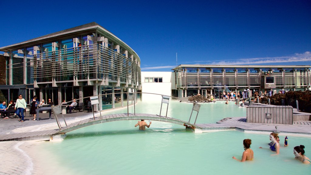 Grindavik featuring swimming and a pool as well as a small group of people