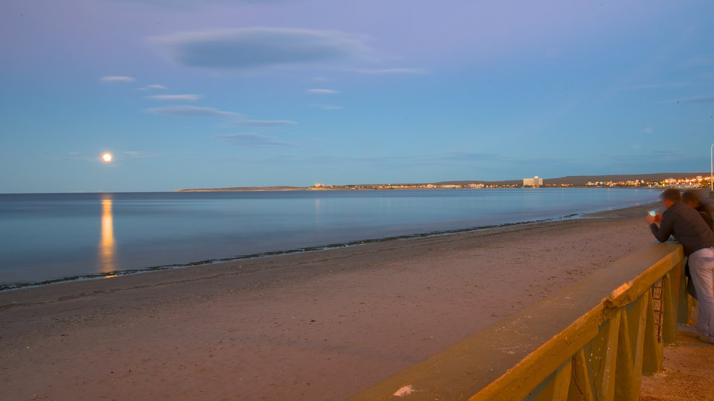 Puerto Madryn Beach which includes general coastal views, a sunset and a beach