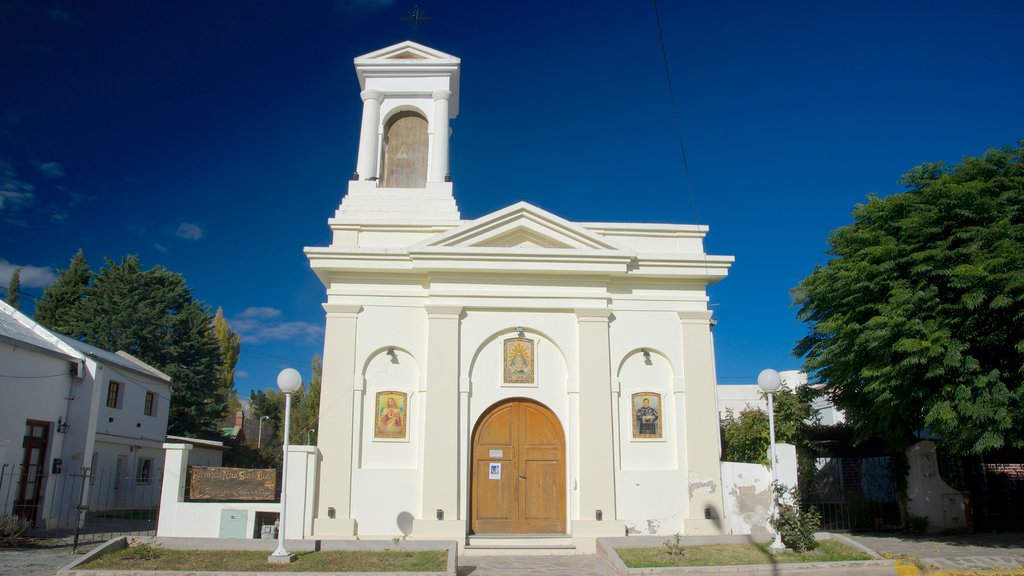 Puerto Madryn which includes a church or cathedral and religious elements
