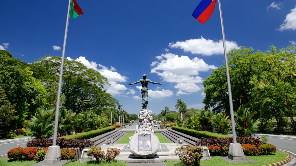 Quezon City featuring a garden and a statue or sculpture