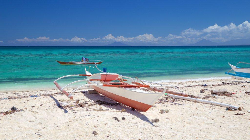 Guimbitayan Beach featuring a sandy beach and general coastal views