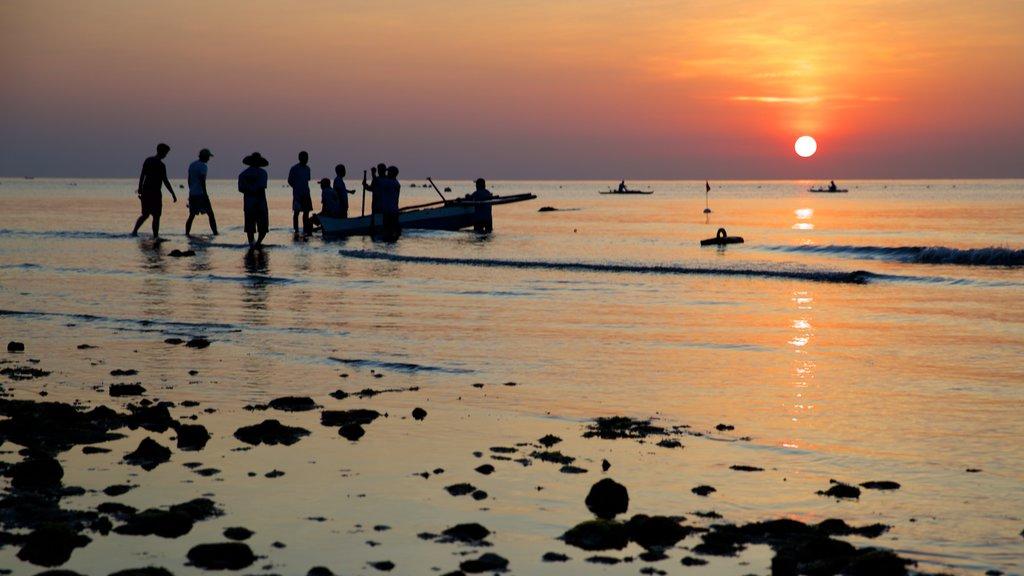 Oslob Beach which includes a sandy beach, general coastal views and a sunset
