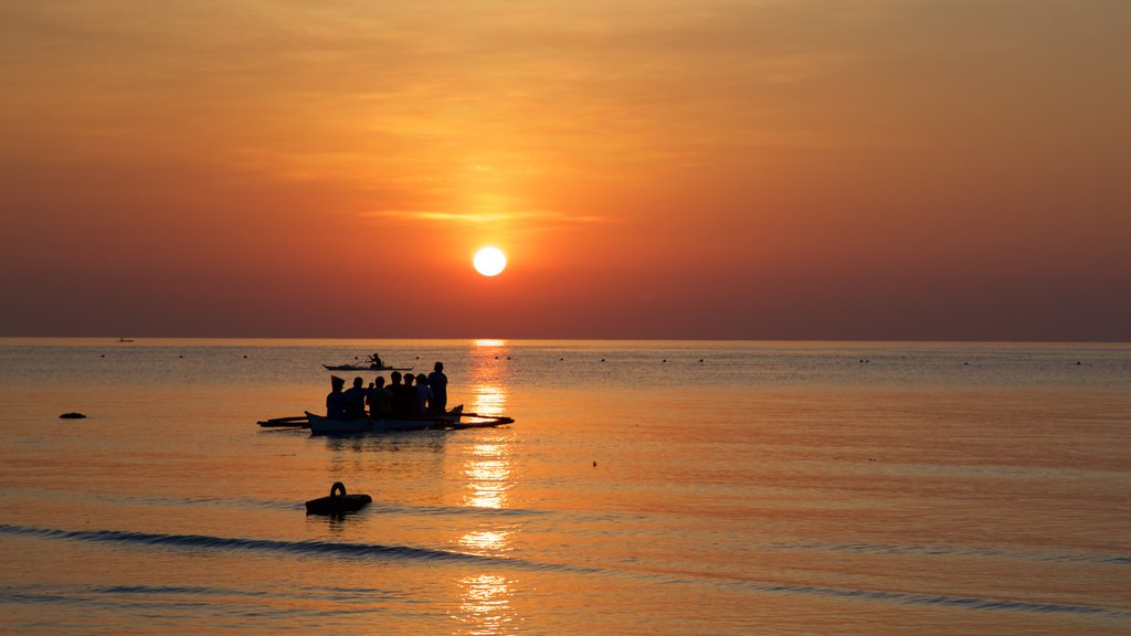 Oslob Beach showing general coastal views, a sunset and boating