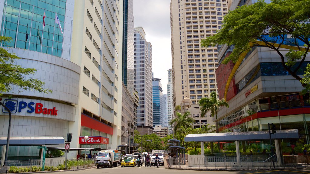 Makati which includes street scenes and a city