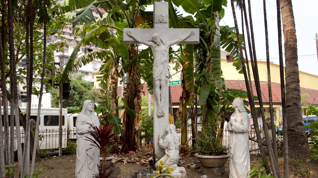 Malate which includes religious elements and a statue or sculpture