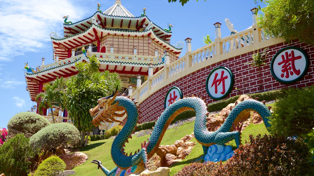 Philippines Taoist Temple featuring a statue or sculpture and a garden
