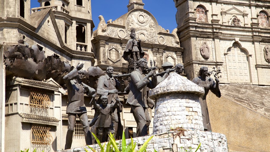 Heritage of Cebu Monument which includes heritage architecture, a statue or sculpture and religious elements
