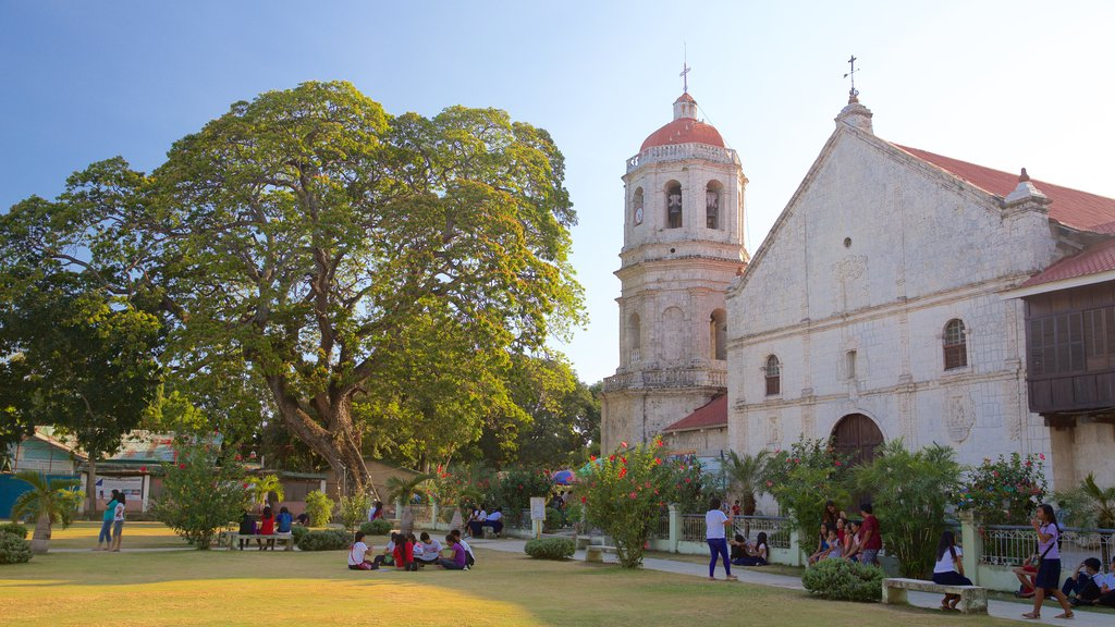 Dalaguete Church showing religious aspects, heritage architecture and a sunset