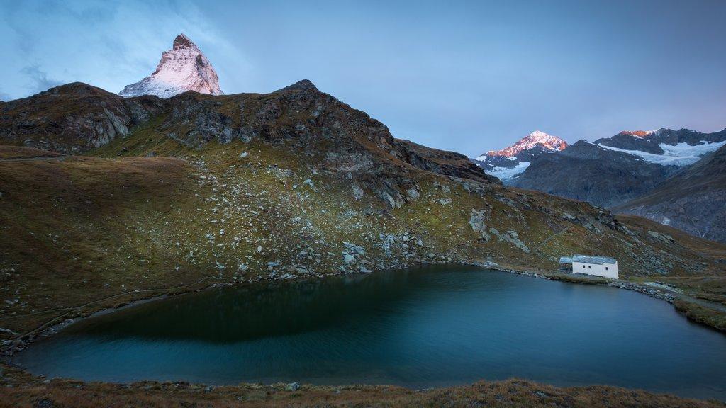 Matterhorn showing a lake or waterhole and a sunset
