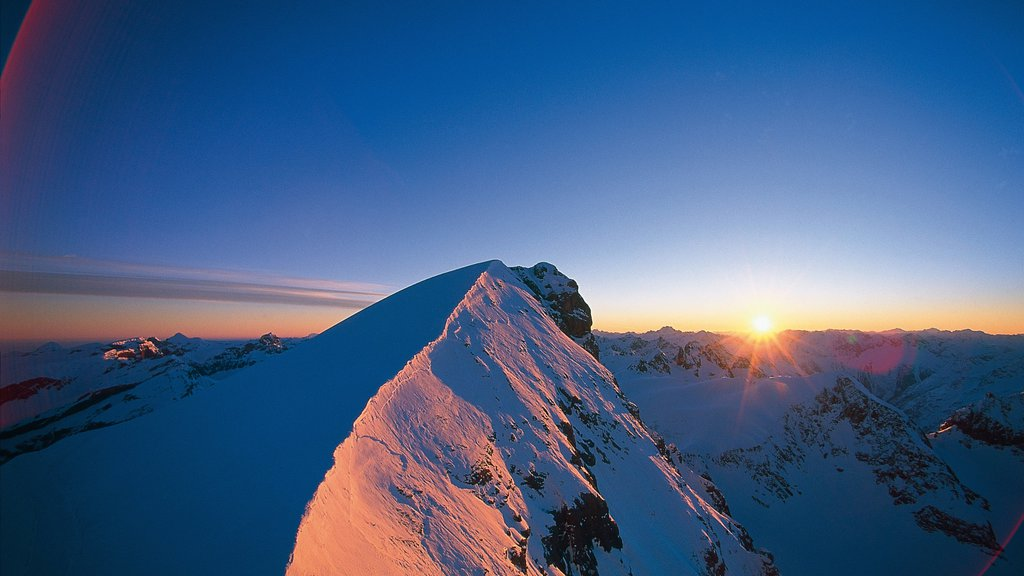 Engelberg-Titlis Ski Resort which includes mountains, a sunset and snow