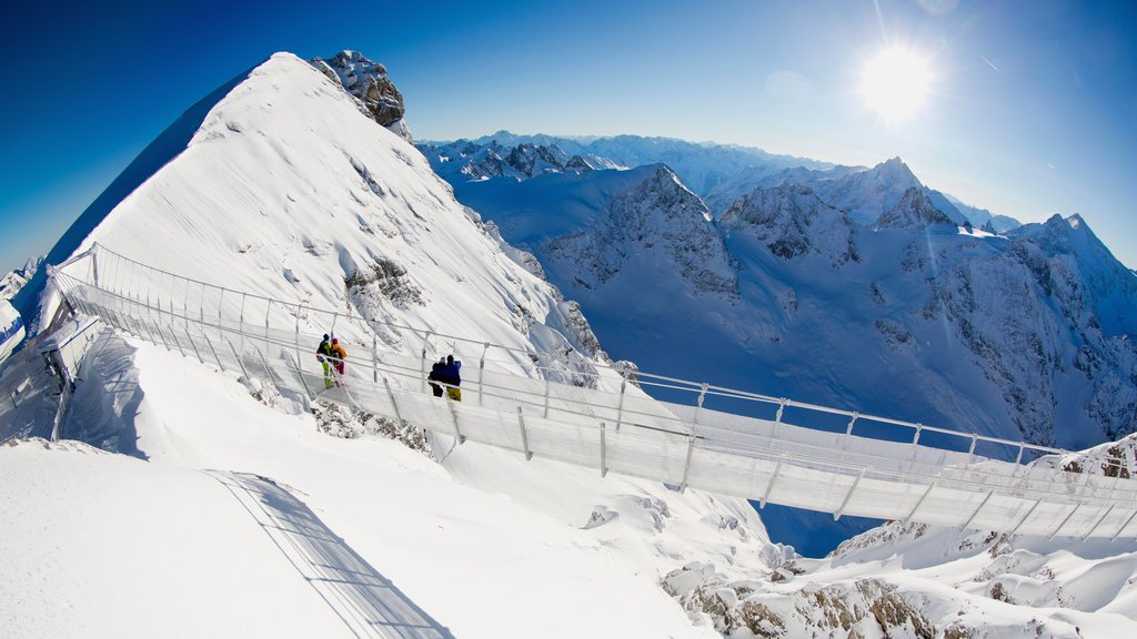 Engelberg-Titlis Ski Resort which includes snow, a suspension bridge or treetop walkway and mountains