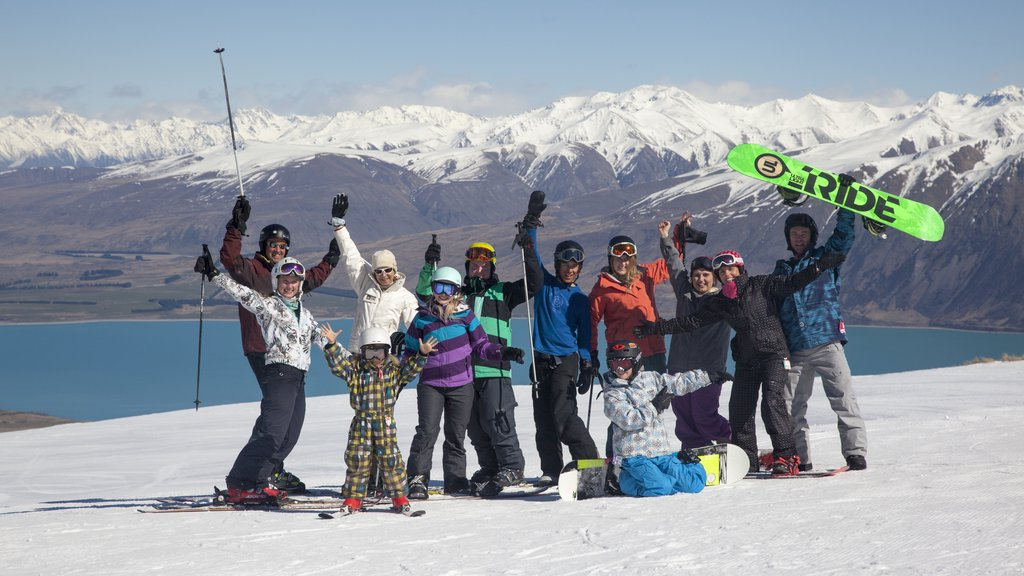 Roundhill Ski Area featuring snow as well as a large group of people