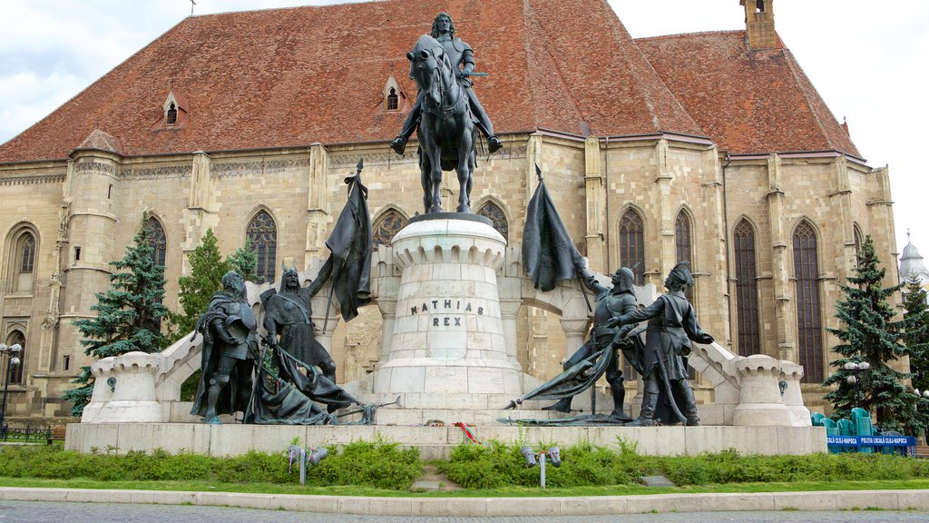 Cluj-Napoca which includes a statue or sculpture and heritage architecture