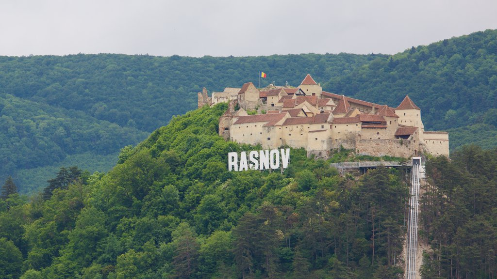 Rasnov Fortress featuring a castle and signage