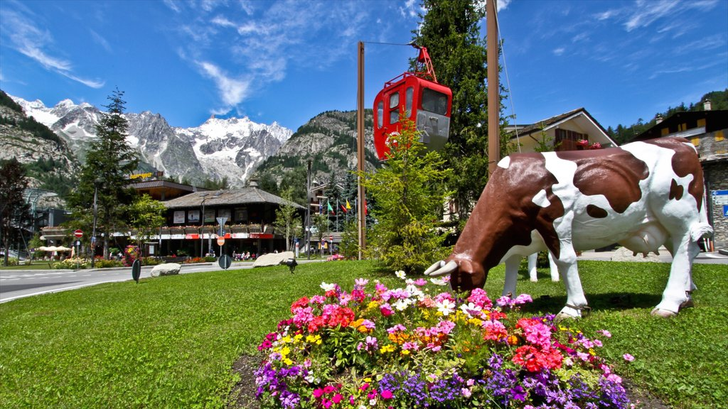 Courmayeur showing a garden and a statue or sculpture