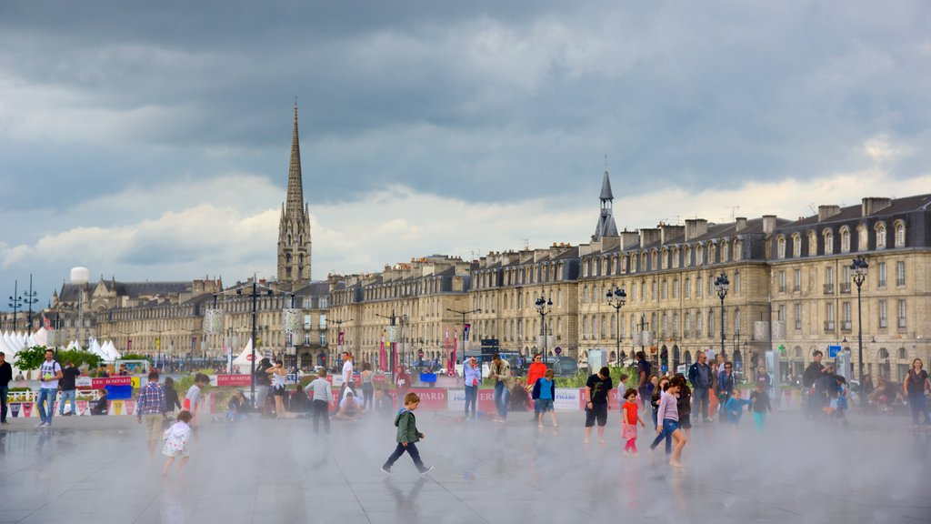 Bordeaux showing mist or fog, a square or plaza and markets