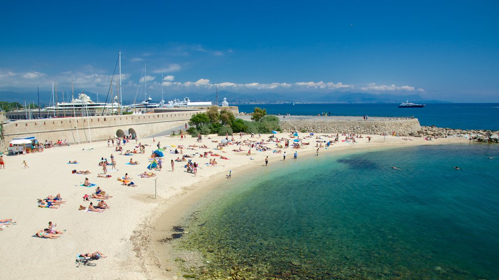 Antibes which includes a beach as well as a large group of people