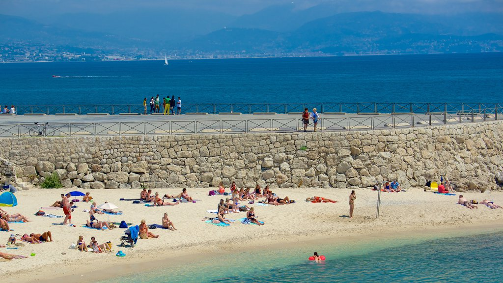 Antibes showing views and a beach as well as a large group of people