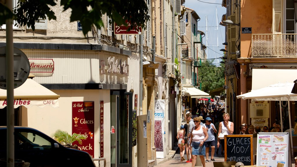 Antibes which includes street scenes and a small town or village as well as a small group of people