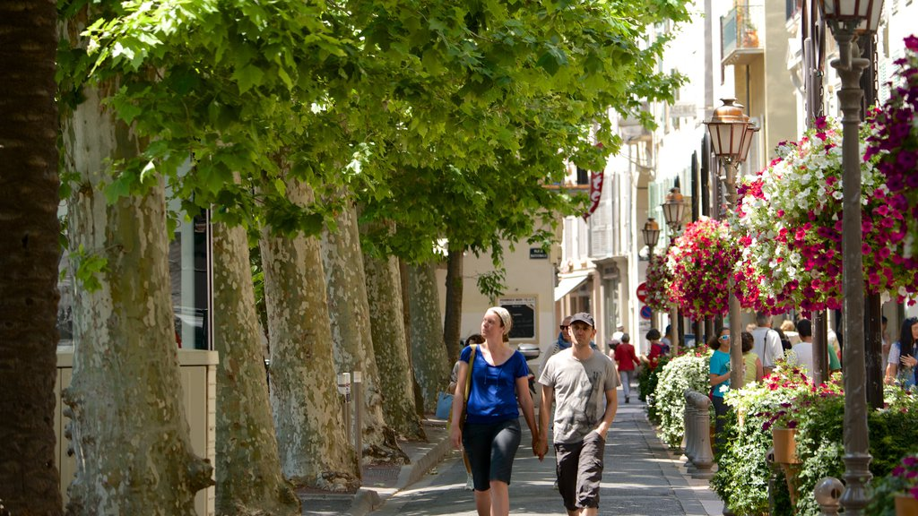 Antibes which includes a park and street scenes as well as a couple