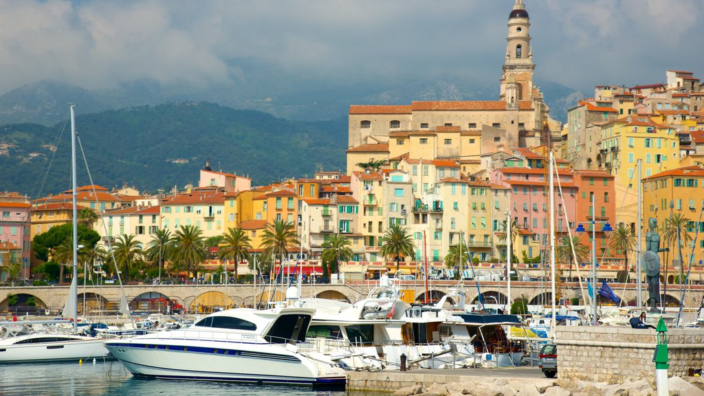 Menton featuring a marina and a coastal town