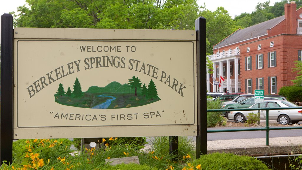 Berkeley Springs State Park showing signage, a park and a small town or village
