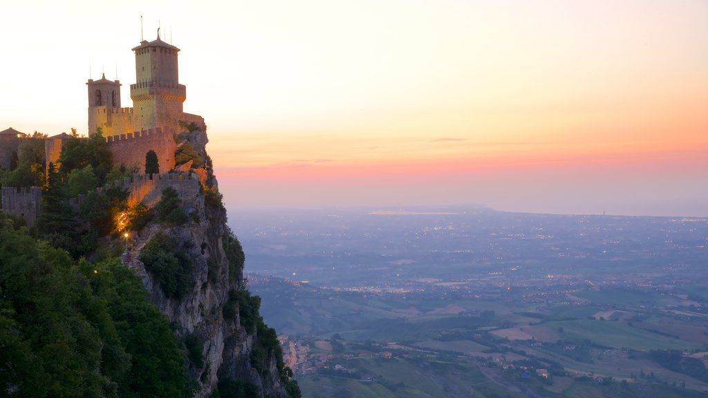 Guaita Tower which includes mountains, a castle and heritage architecture
