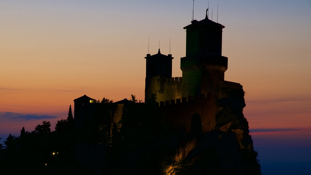 Guaita Tower which includes a sunset, heritage architecture and chateau or palace