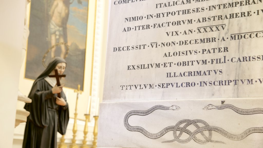 Basilica of Saint Marino showing a church or cathedral, signage and interior views