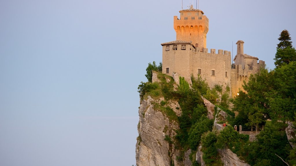 Cesta Tower which includes mountains, a castle and heritage architecture