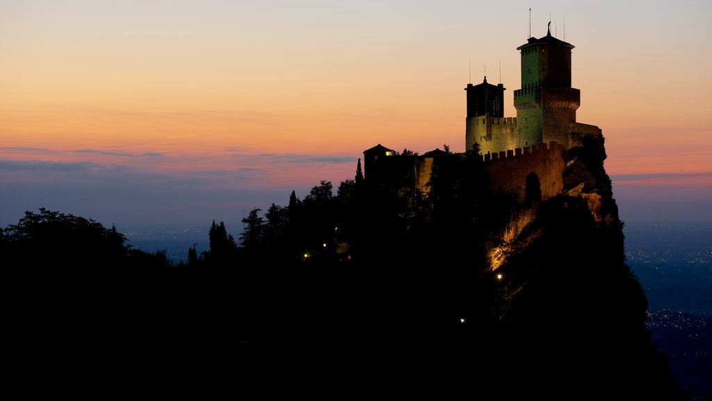 Guaita Tower featuring chateau or palace, a sunset and mountains