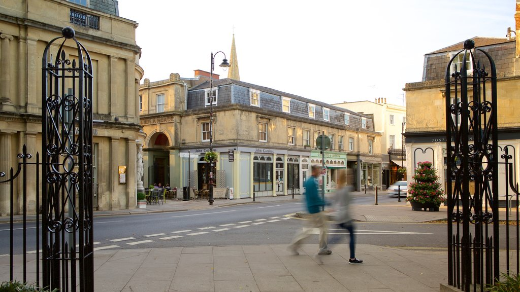 Cheltenham which includes a city and street scenes