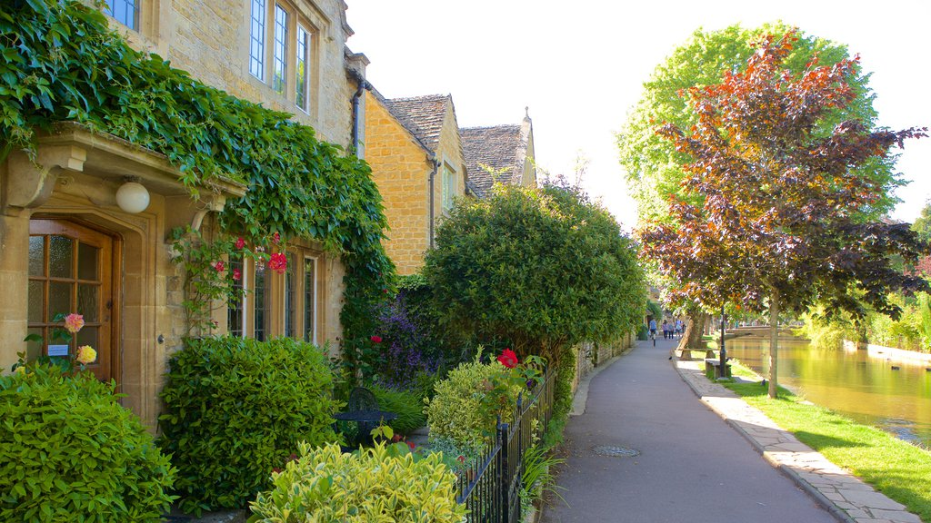 Bourton-on-Water featuring a garden, a river or creek and a house