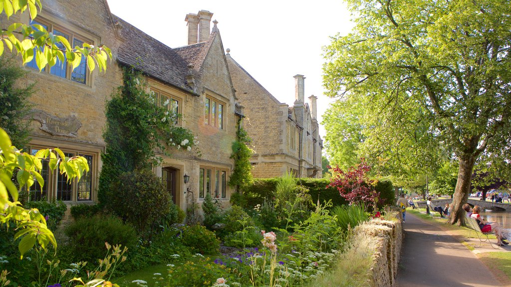Bourton-on-Water featuring a house, a garden and heritage elements