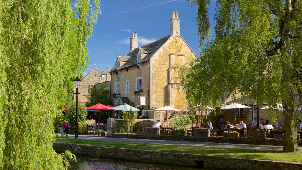 Bourton-on-Water which includes a river or creek, a small town or village and outdoor eating