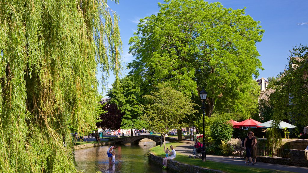 Bourton-on-Water featuring a river or creek, swimming and a small town or village