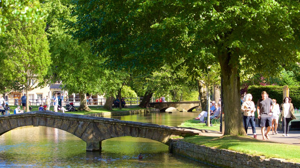 Bourton-on-Water featuring a garden, a bridge and a river or creek