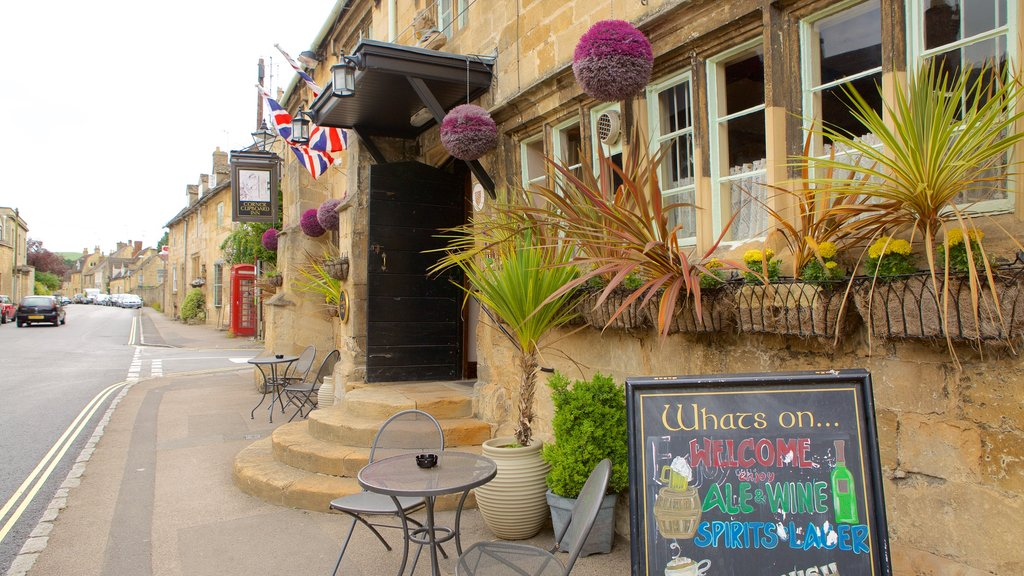 Winchcombe showing a bar, a small town or village and signage