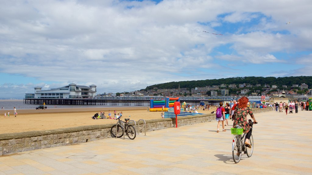 Weston-super-Mare showing a sandy beach, a coastal town and street scenes