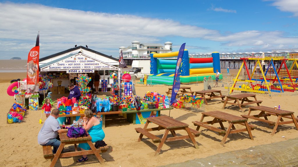 The Grand Pier showing a festival, a beach and outdoor eating