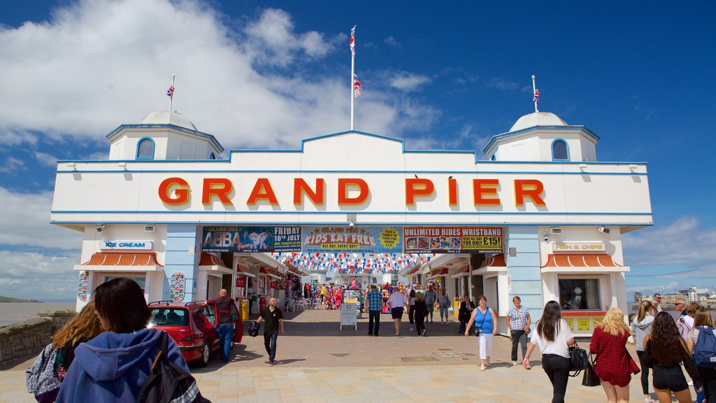 The Grand Pier which includes a festival and signage as well as a large group of people