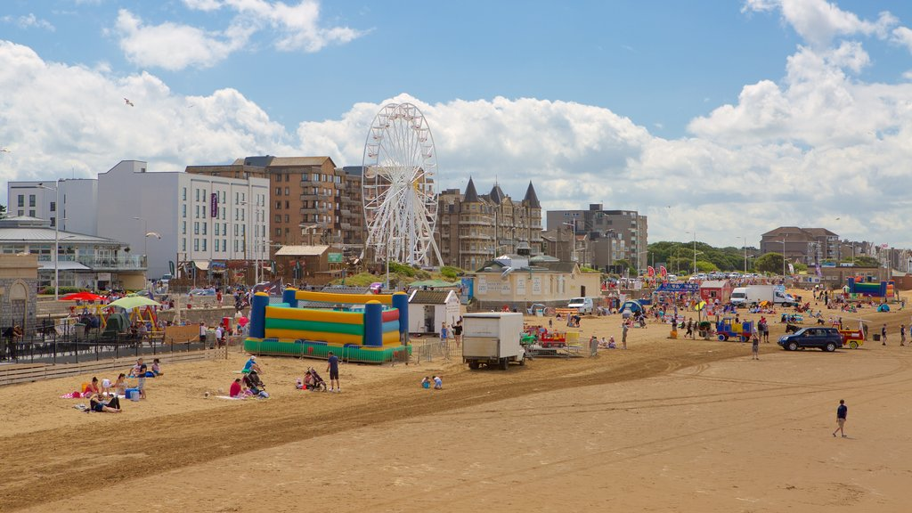 Weston-super-Mare showing a beach, a festival and rides