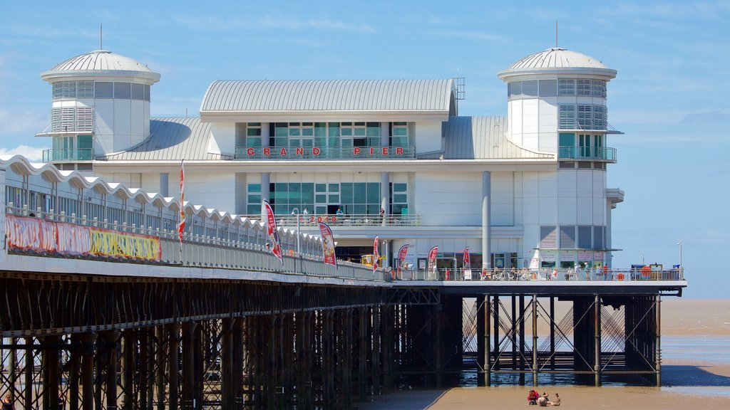 The Grand Pier which includes views, a sandy beach and signage