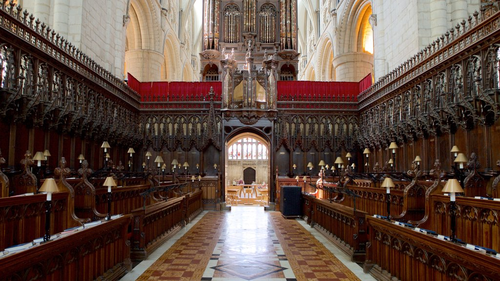 Gloucester Cathedral featuring a church or cathedral, religious elements and interior views