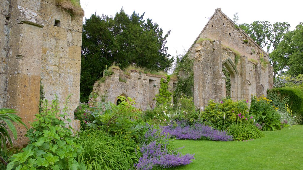 Sudeley Castle featuring building ruins, a garden and heritage elements